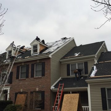 laying shingles on the roof of a Doylestown home