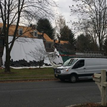 dropcloth on house while working on roof in Doylestown