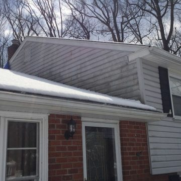 photo of damaged vinyl siding