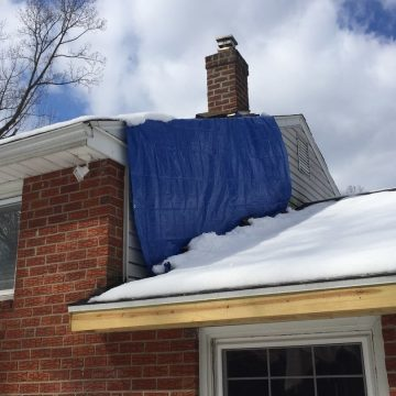 drop-cloth to protect home while removing the damaged vinyl siding