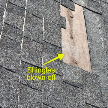 Before: Some of the shingles had blown off of the roof