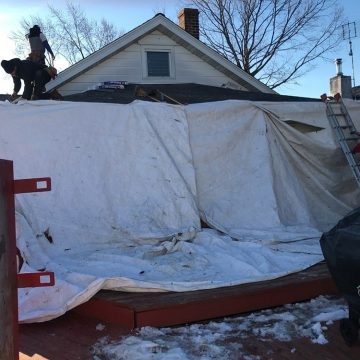 We always start by hanging a system of plywood and tarps to protect our client's property