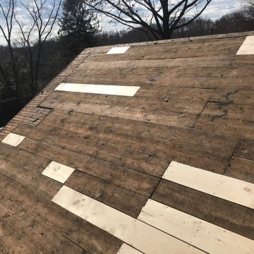 We filled in the damage parts of the roof with new wood