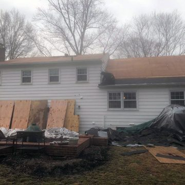 Rear view of Wallingford house with shingles removed