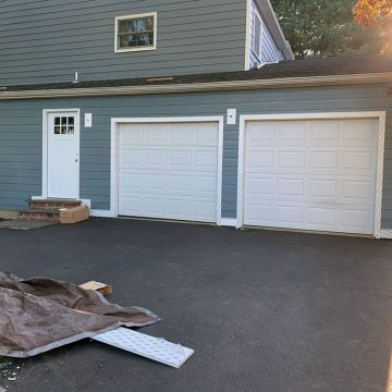 new garage doors with new siding