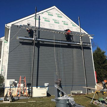 For this home, James Hardie Night Gray siding was used.