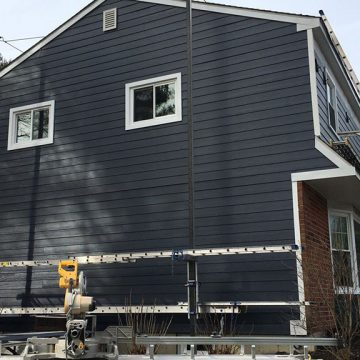 We installed James Hardie Ocean Blue siding, new windows, and trim.
