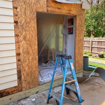 To get started, we stripped the home's old siding.